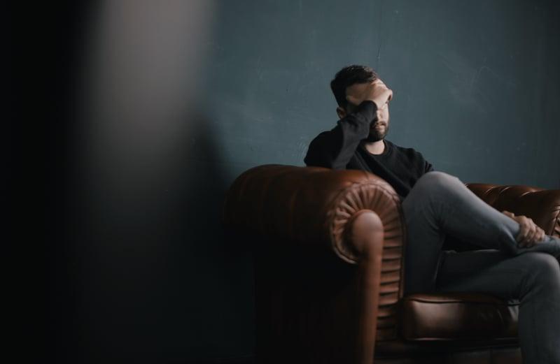 sad man on sofa