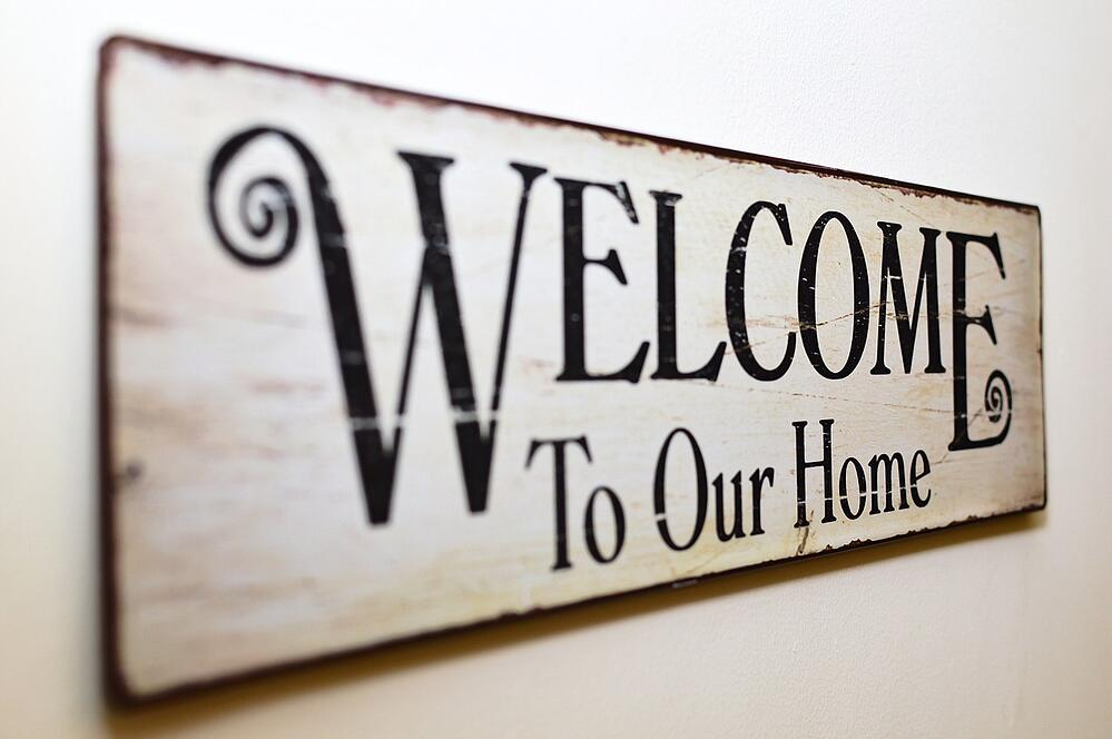 welcome to our home sign - shared housing